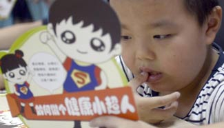 Children in E China listen to food security lectures