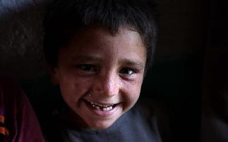 In pics: Afghan children in displaced camp