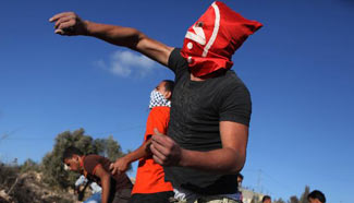 Palestinian protesters clash with Israeli soldiers near Ramallah, Nablus