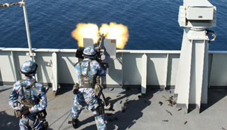 Chinese navy soldiers take part in shoot training during escort missions