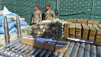 Pakistani officers display arms and ammunition in Quetta