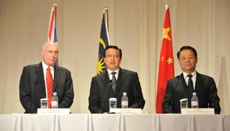 China, Malaysia, Australia agree to double search zone of MH370