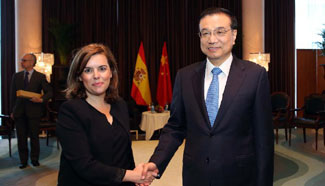 Premier Li arrives in Spain during stopover after concluding four-nation tour