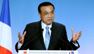 Premier Li addresses closing ceremony for business summit in SW France