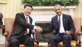 Chinese President Xi talks with Obama at White House