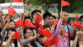 Overseas Chinese wait for President Xi at China Cultural Center in Singapore