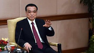Premier Li meets Malaysian industrial and commercial representatives