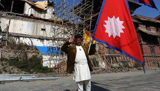 "Feature: ""Flag Man"" urges youth of quake-ravaged Nepal to gear up for reconstruction"