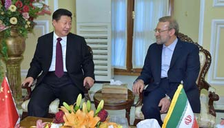 President Xi meets with Iranian parliament speaker in Tehran