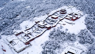 Drone photo: birdview of Golden Budda Mountain covered in snow