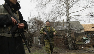 Armed militants patrol in Donetsk, Ukraine