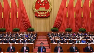Chinese leaders attend closing meeting of 12th NPC's 4th session