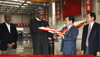Nigerian president visits Shanghai Aircraft Design and Research Institute of COMAC