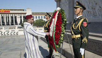 King Mohammed VI of Morocco lays wreath to Monument to People's Heroes