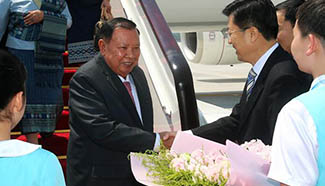 Lao president arrives in Hangzhou to attend G20 Summit