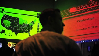 People watch live broadcast of ballot counting of U.S. presidential election