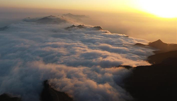 In pics: sea of clouds scenery at Huaying Mountain in SW China