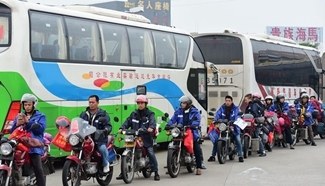 Migrant workers ride motrocycles home for Spring Festival in S China