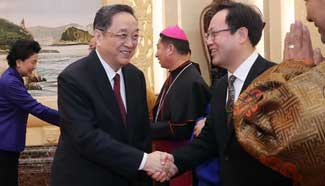 Top political advisor stresses CPC's leadership on religions