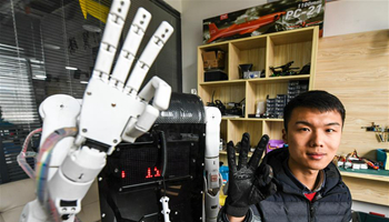 Robot adept in interpreting sign language developed in C China