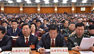 Deputies attend opening meeting of 5th session of 12th NPC