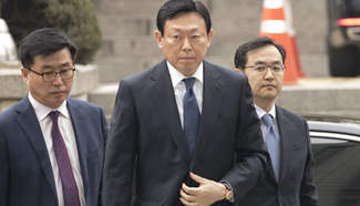 Lotte Group Chairman arrives to attend trial at Seoul Central District Court