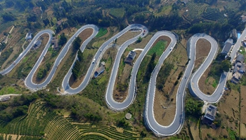 In pics: winding mountain road looks like jade belt in central China