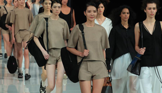 Models present accessories by designers at China Fashion Week