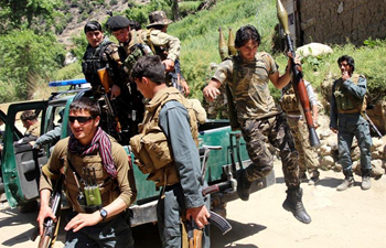 Afghan security forces members attend military operation