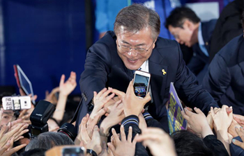S. Korean presidential frontrunner widens gap with runner-up in opinion polls