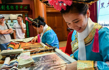 Bohai Mohe embroidery exhibition held in NE China