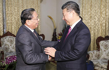 Xi meets former Lao president