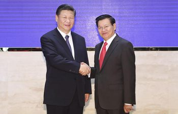 President Xi meets Lao PM in Vientiane