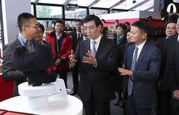 Wang Huning visits internet expo in Wuzhen