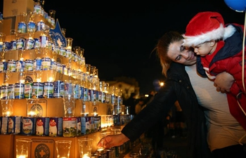 "Athens' Christmas ""milk tree"" feeds thousands of people in need"