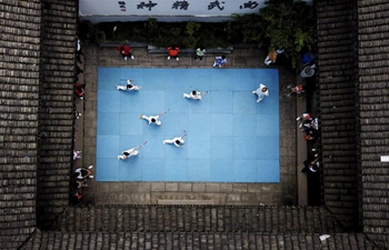 Children practise martial arts at Wenzhou Wushu Museum, east China's Zhejiang