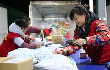 Workers busy dealing with packages during Singles' Day online shopping promotion