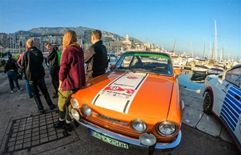 People attend vintage race car show in La Condamine, Monaco
