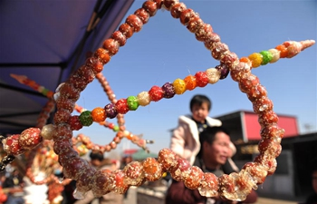 Tanghulu sold during activity to greet upcoming Lantern Festival in north China's Hebei