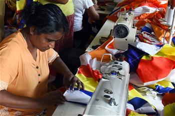 Sri Lankan tailor makes flag for upcoming Vesak festival