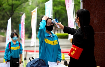 Students in final year of junior high schools in Hebei return to campus