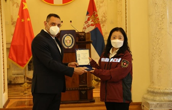 Chinese medical experts awarded by Serbia for assistance in fighting COVID-19