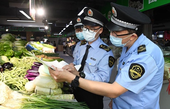 Market regulation administration staff inspect market, restaurant in Haidian District of Beijing