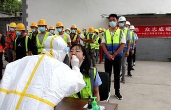 Workers receive nucleic acid tests at construction site in Dongcheng District of Beijing