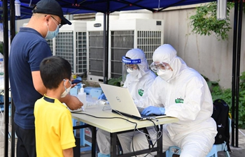 Communities in Beijing take strict measures to prevent spread of COVID-19 pandemic