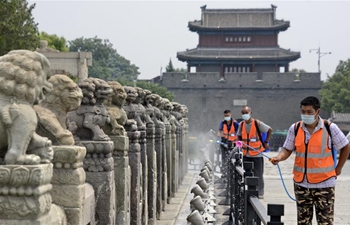 Staff members conduct disinfection in Beijing