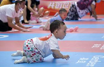 Baby crawling contest held in Beijing
