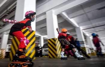 Children wearing face masks roller-skate amid COVID-19 pandemic in Indonesia