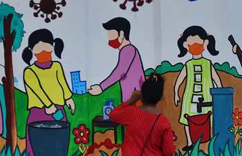 Art school students draw wall paintings in Agartala, India