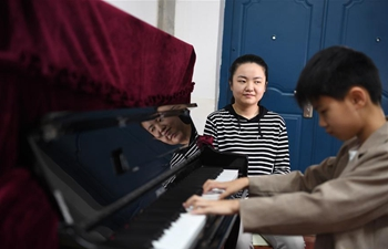 Across China: Piano sheds light, melody on a world of darkness